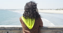 Black woman waiting by the pier - stock footage