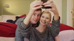 Couple taking selfies in their bedroom Stock Footage