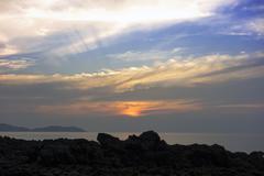 Rays Of The Setting Sun on Charlie Beach Stock Photos