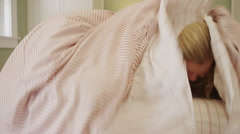 Young couple smiling under the covers Stock Footage
