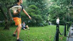 Stock Video Footage of Healthy Lifestyle of Active Young Men in New York Playing Frisbee
