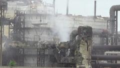 Destroyed dirty factory, steam comes out of pipe Stock Footage