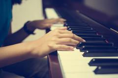 Girl's hands on the keyboard of the piano : Vintage filter Stock Photos