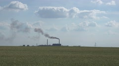 Ferroalloy plant on the background of clouds and smoking pipes Stock Footage