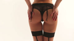 buttocks of a woman wearing stockings and suspender belt Stock Footage