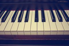 Close-up of piano keys. close frontal view : Vintage filter Stock Photos