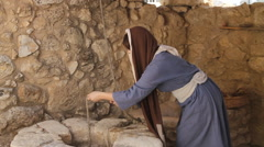 Stock Video Footage of Biblical Re-enactment of Woman Drawing Water at the Well