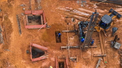 Timelapse View of Men Working at Construction Site Seen from Above - Zoom Out - stock footage