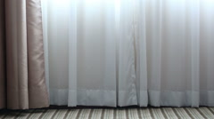 The wind blows and light shines through white curtains Stock Footage