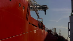 Shipping vessel worker oversees duties Stock Footage