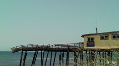 Old hurricane damaged pier and shop Stock Footage