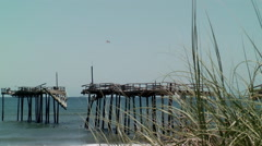 Hurricane damaged pier sea grass Stock Footage