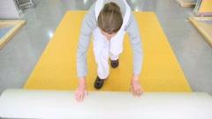 Craftsman installing plastic flooring Stock Footage