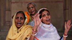Women in traditional Indian saris glorify Krishna in the old Ashram. Stock Footage