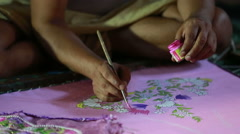 Artist painting on silk in Indian temple. Close up. - stock footage