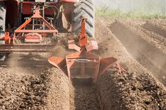 tractor preparation soil working in field agriculture. - stock photo