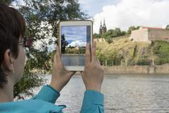 Sightseeing, taking photo of sight - stock photo