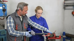 Young woman in professional training to become plumber - stock footage