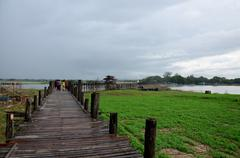 U Bein Wooden longest Bridge in rainning time at Amarapura, Myanmar. Stock Photos