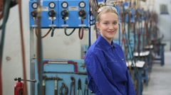 Young woman apprentice in metallurgy workshop - stock footage