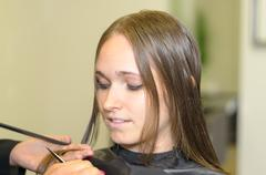 Hairstylist Cutting the Hair of a Young Woman Stock Photos
