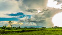 Clouds over the green field Stock Footage