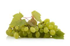 Bunch of white grapes isolated on white background with leaf - stock photo