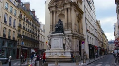 PARIS, POV, walking on city street by monument of Molier, steadicam. Stock Footage