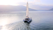Stock Video Footage of Aerial view of young people ride on a catamaran boat at sea bay RG