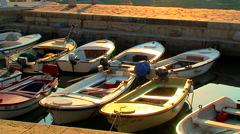 Boats docked in the marina at the sunrise - stock footage