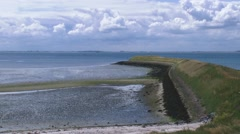 Eastern Scheldt breakwater + pan tidal estuarine marshes Stock Footage