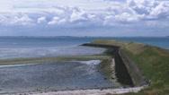 Stock Video Footage of Eastern Scheldt breakwater + pan tidal estuarine marshes