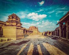 Vintage retro hipster style travel image of Krishna temple on sunset with gru Stock Photos