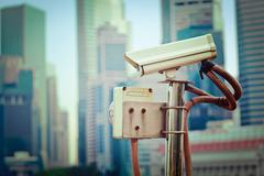 Vintage retro hipster style travel image of CCTV surveillance camera in Singa Stock Photos