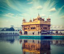 Vintage retro hipster style travel image of Sikh gurdwara Golden Temple (Harm - stock photo