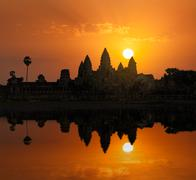 Cambodia landmark Angkor Wat with reflection in water on sunrise - stock photo