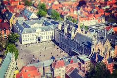 Vintage retro hipster style travel image of aerial view of the Burg square wi Stock Photos