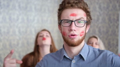 Lucky Guy Covered in Kisses by Beautiful Young Girls on Light Background Stock Footage
