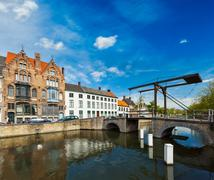 Canal with old bridge. Bruges (Brugge), Belgium Stock Photos