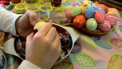 Boy peeling hard cooked easter eggs closeup Stock Footage