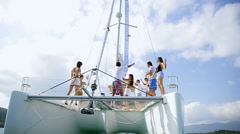 Young people have a party on the boat Stock Footage