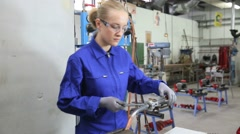Student in plumbing professional training, working on metal Stock Footage
