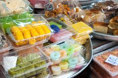 Collection of Thai desserts and sweets at a Bangkok market Stock Photos