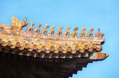 Ornate roof figurines at the Forbidden City, Beijing, China Stock Photos