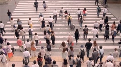 Pedestrians crossing busy street in Osaka, Japan HD - stock footage