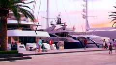 People watch luxury yachts and boat Stock Footage