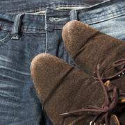 leather shoes on jean pant - stock photo