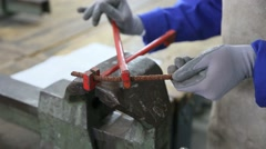 Closeup of worker shaping piece of steel in workshop Stock Footage