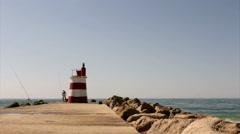 Tavira Island Inlet Jetty ocean view and Fisherman, Algarve. Stock Footage