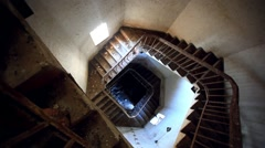 Dark spiral staircase with window into a lighthouse Stock Footage